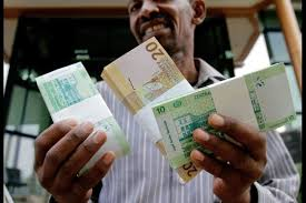 Man with Sudanese currency