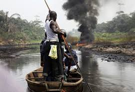 Police patrolling the creeks of Arepo village.