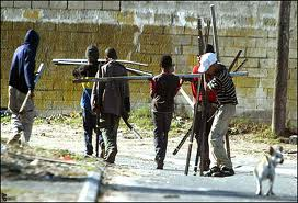 Hoodlums carting away vandalized electricity infrastructure.