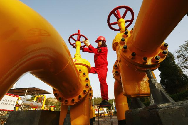 A-Chinese-worker-checks-a-gas-pipe-valve-at-a-natural-gas-plant-in-southwest-Chinas-Sichuan-province..jpg