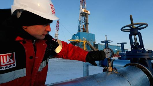 A-worker-at-the-Lukoil-company-owned-Imilorskoye-oilfield-in-Kogalym-Russia.jpg