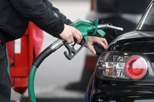 A-motorist-refueling-at-a-petrol-pump.jpg