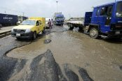 Morotists-stuck-in-traffic-on-waterlogged-potholes-on-the-Apapa-Oshodi-expressway-in-Lagos-174x116.jpg