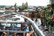 Nigerian-military-personnel-inspecting-impounded-vessels-allegedly-being-used-for-illegal-bunkering-activities.-174x116.jpg