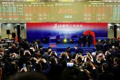 People-attend-the-launch-ceremony-of-Shanghai-crude-oil-futures-at-the-Shanghai-International-Energy-Exchange-174x116.jpg