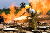 Local-dweller-drying-food-stuff-next-to-a-gas-flaring-stack-174x116.png