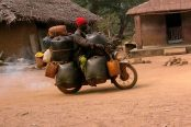 A-cyclist-smuggling-fuel-through-a-village-at-the-Nigeria-Benin-border-174x116.jpg