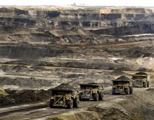 Mining trucks at the Albian Sands tar sands project tin Alberta, Canada.