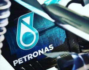 Malaysia's Petronas flags weaker demand as quarterly profit halves