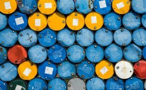 Oil falls as supply worries fade; stocks edge higher