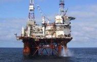 Oil rises ahead of hurricane's landfall but bleaker demand outlook weighs
