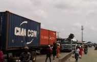 Fuel & articulated trucks block East-West road as youths protest